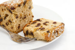 Fruit cake sliced on white plate Stock Images