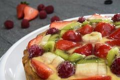 Fruit cake on stone table Royalty Free Stock Photo