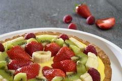 Fruit cake on stone table Stock Photo