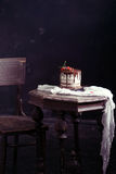 Fruit cake on the table in rustic kitchen; selective focus; vint Stock Photo