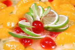 Fruit pie Topping with oranges and lime slices. Some lime slices, cherries and plenty of orange fruits on a pie topping Stock Photography