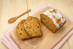 Fruit cake with two slices on a linen napkin and a light wooden. Homemade fruit cake with two slices on a linen napkin and a light wooden board near a wooden Stock Photography