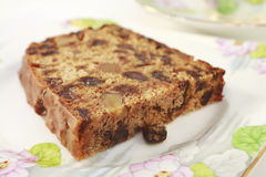 Fruit Cake with Walnuts. A fruit cake with walnuts which contains no fat, known as Irish Tea Bread. On pretty floral crockery for afternoon tea Royalty Free Stock Photo