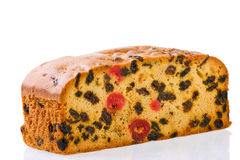 Fruit cake on white background with reflection. Stock Image