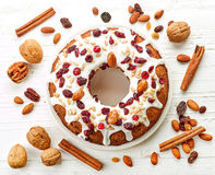 Fruit cake on white plate. On wooden table, top view stock photo