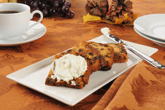 Fruit cake wiwth cream cheese. Sliced fruit cake with cream cheese and coffee on a holiday table royalty free stock photos