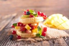 Fruit cake. On wood background stock photo