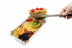 Fruit cake on wooden spoon Stock Image