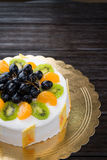 Fruit cake on wooden table Royalty Free Stock Photos