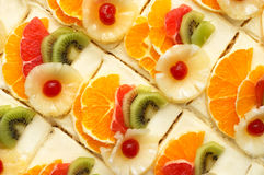 Fruit cakes. Many fruit cakes with custard. suitable as background Stock Image