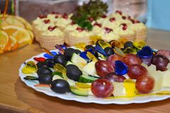 Fruit canape with colored plastic heart skewers on cocktail or a buffet table stock image