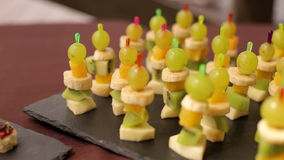 Fruit canapes on table at a buffet or Banquet. Fruit canapes on table at a buffet or Banquet, close-up stock video