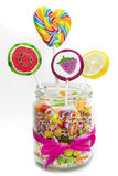Fruit candies and lollipops in jar Royalty Free Stock Image