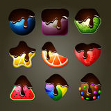 Fruit candies for match three puzzle game with chocolate topping Royalty Free Stock Image