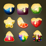Fruit candies for match three puzzle game with chocolate topping Stock Images