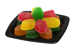 Fruit candy on a black plate Stock Photo
