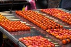 Fruit candy look so bright and vivid and delicious selling by street vendor. Stock Image