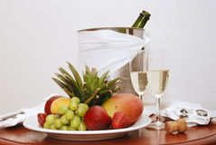 Fruit and Champagne. A romantic snack for two - champagne and a fruit plate Stock Photography