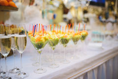 Fruit and Champagne Glasses Stock Photography