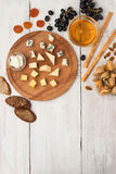Fruit and cheese assorted on the white wooden table vertical Stock Photos