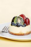 Fruit cheese cake with fork Royalty Free Stock Photography
