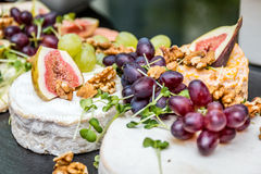 Fruit and cheese. Plate in a conference Stock Images