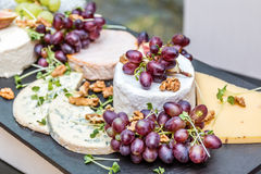 Fruit and cheese. Plate in a conference Stock Photo