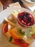 Fruit and cheese. Cheese plate with fruits and yougurt Stock Photos