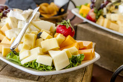 Fruit and Cheese Tray on Display. Tray of assorted fruit and cheese at catered event Stock Photos