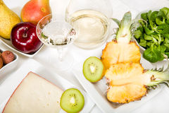 Fruit, cheese and wine Stock Images