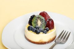 Fruit cheesecake on a plate with fork Royalty Free Stock Image