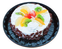 Fruit chocolate cake with a delicious cream. On a white backgrou. Nd Royalty Free Stock Images