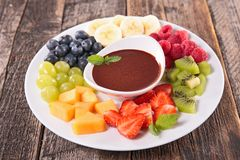 Fruit and chocolate sauce. Fresh fruit and chocolate sauce Stock Images