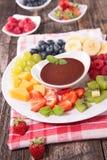 Fruit and chocolate sauce Stock Photos