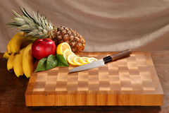 Fruit on a chopping board Royalty Free Stock Photos
