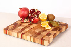Fruit on a chopping board Royalty Free Stock Photography