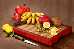 Fruit on a chopping board Stock Images