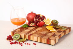 Fruit on a chopping board Stock Photo