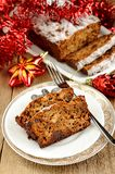 Fruit christmas cake with christmas toys. On wood table Royalty Free Stock Photo