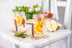 Fruit Christmas Infused Detox Water with apple, orange, cinnamon and clove spice. Cold Fruit Christmas Infused Detox Water with apple, orange, cinnamon and clove Royalty Free Stock Photography