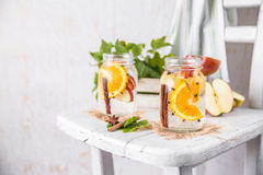 Fruit Christmas Infused Detox Water with apple, orange, cinnamon and clove spice. Cold Fruit Christmas Infused Detox Water with apple, orange, cinnamon and clove Royalty Free Stock Images