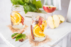 Fruit Christmas Infused Detox Water with apple, orange, cinnamon and clove spice. Cold Fruit Christmas Infused Detox Water with apple, orange, cinnamon and clove Stock Image
