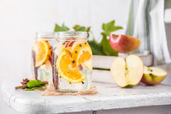 Fruit Christmas Infused Detox Water with apple, orange, cinnamon and clove spice Stock Photography