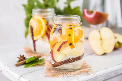 Fruit Christmas Infused Detox Water with apple, orange, cinnamon and clove spice Royalty Free Stock Image