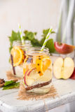 Fruit Christmas Infused Detox Water with apple, orange, cinnamon and clove spice. Cold Fruit Christmas Infused Detox Water with apple, orange, cinnamon and clove Royalty Free Stock Image