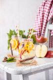 Fruit Christmas Infused Detox Water with apple, orange, cinnamon and clove spice. Cold Fruit Christmas Infused Detox Water with apple, orange, cinnamon and clove Stock Photos