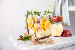 Fruit Christmas Infused Detox Water with apple, orange, cinnamon and clove spice Stock Photo