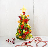 Fruit Christmas tree with different berries, fruits and mint Stock Photos