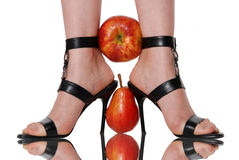 Fruit clamped between feet Royalty Free Stock Photography