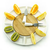 Fruit clock. A Fruit shapes clock point to 3 oclock Stock Image